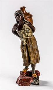 AN IRONCAST FIGURE SHOWING A WOMAN CARRYING