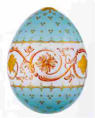A LARGE AND LIGHT BLUE PORCELAIN EASTER EGG WITH GOLD