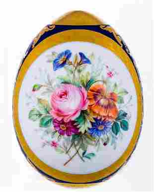A LARGE PORCELAIN EASTER EGG WITH FLOWERS