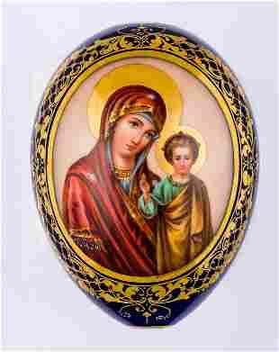 A LARGE PORCELAIN EASTER EGG SHOWING THE MOTHER OF GOD