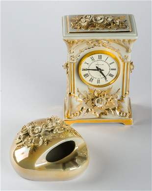 A PORCELAIN TABLE CLOCK AND ASHTRAY