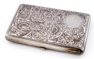 A RUSSIAN SILVER CIGARETTE CASE WITH FLORAL DECOR