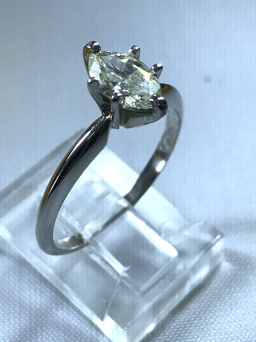 14k White Gold Ring with Diamond.