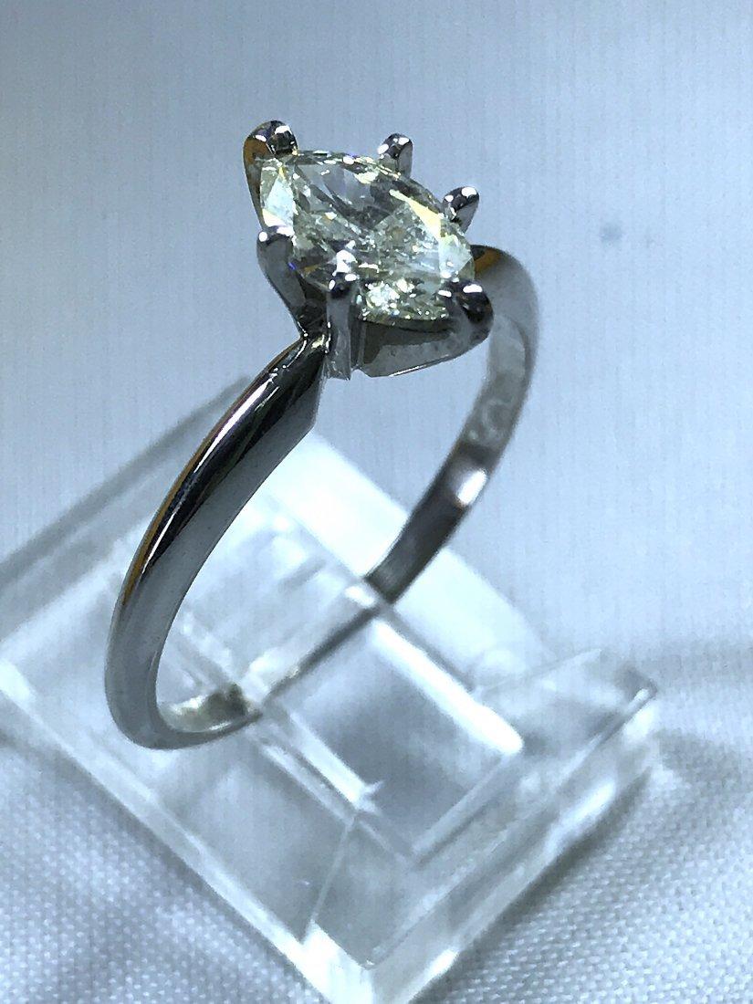 14k White Gold Ring with Diamond.