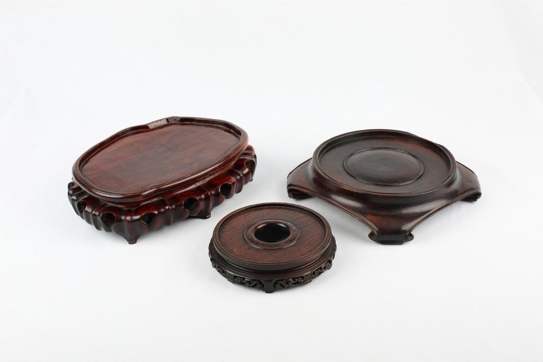 A SET OF THREE CHINESE WOOD STANDS