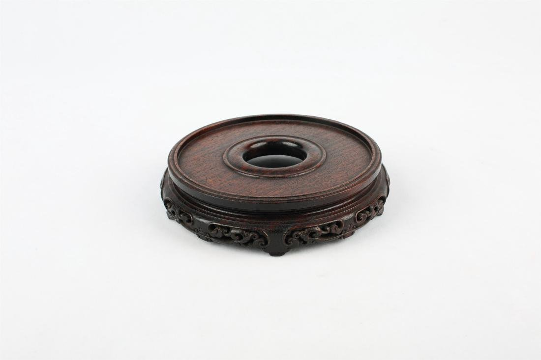 A SET OF THREE CHINESE WOOD STANDS - 3