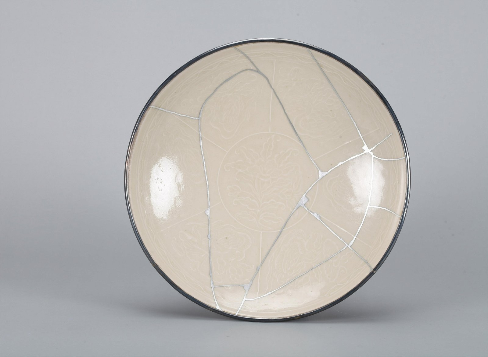 A Chinese Ding-Type Porcelain Plate