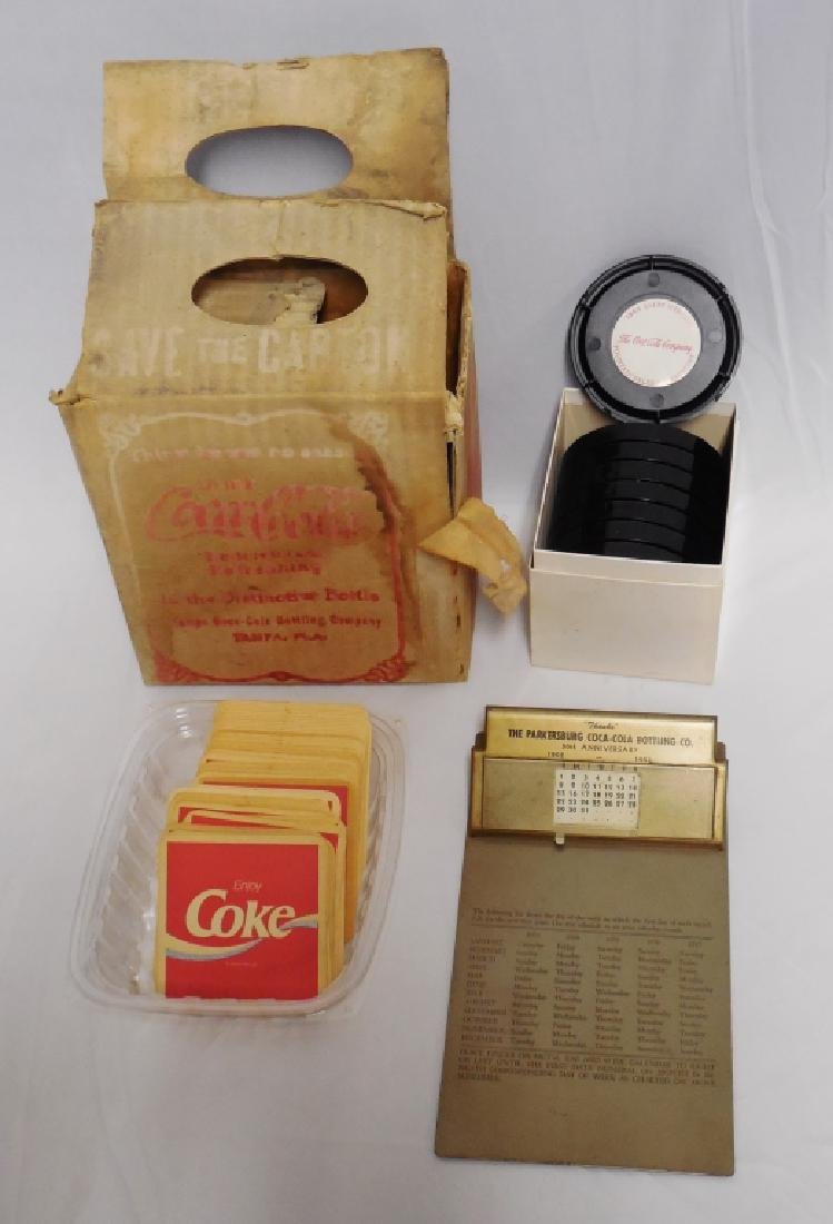 Coca-Cola Coasters, Clipboard, and Cardboard Box