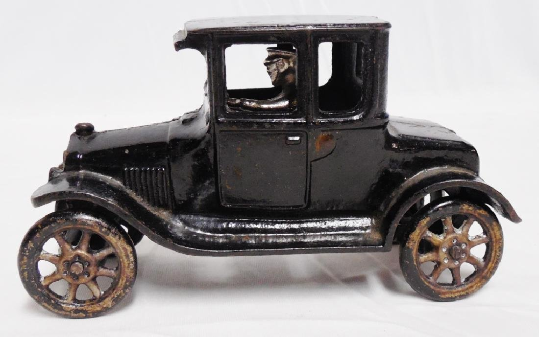 Arcade Cast Iron Car with Man