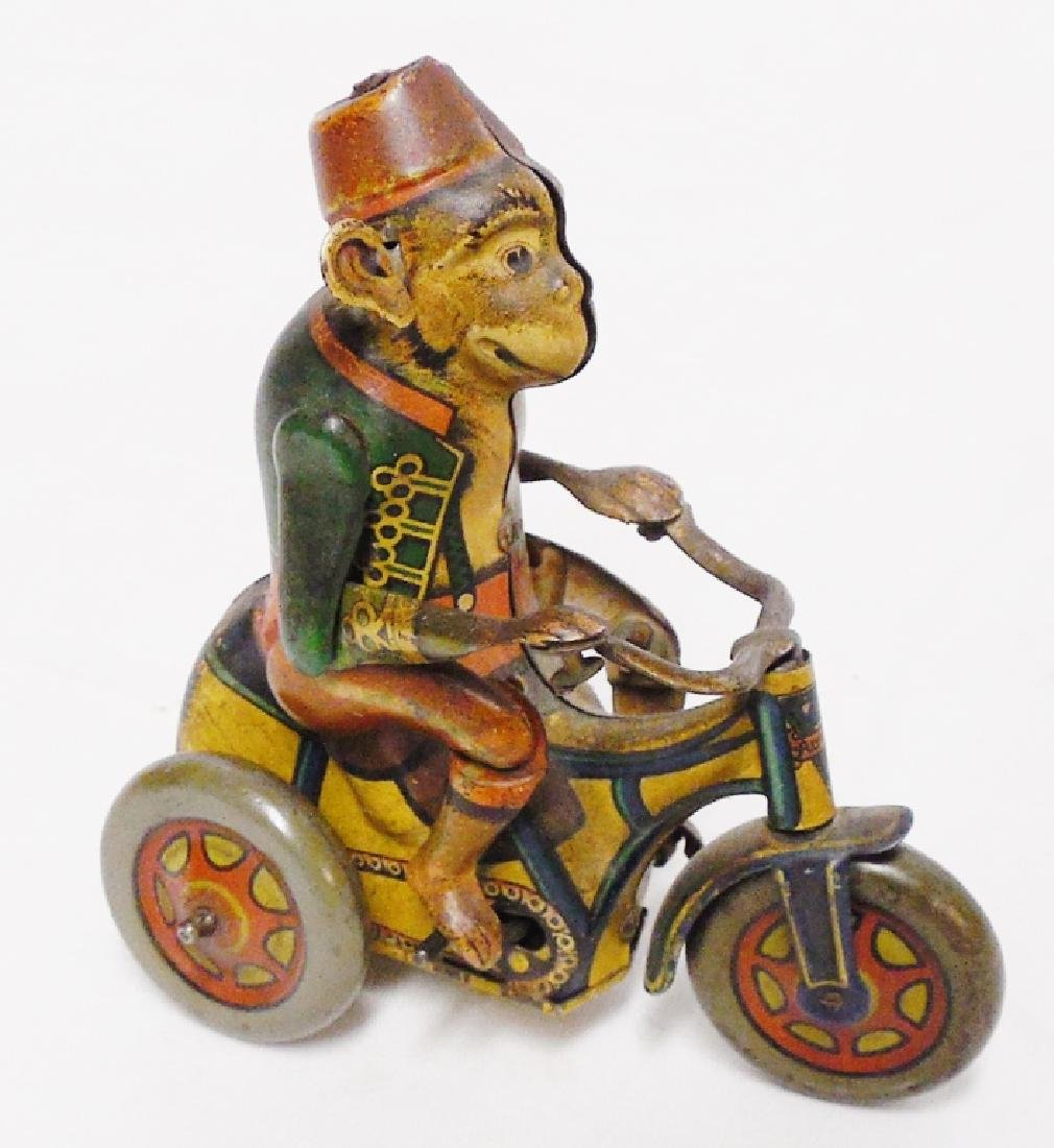 "Tin Monkey on Tricycle ""Made in Germany US Zone"""