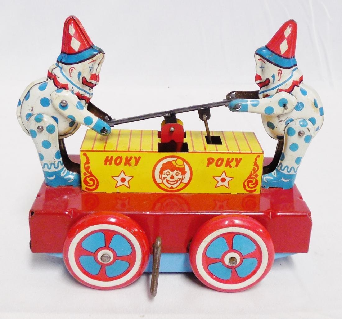 """""""Hoky Poky"""" Windup Tin Clowns on Railway Car"""