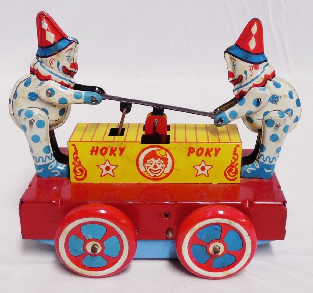 """""""Hoky Poky"""" Windup Tin Clowns on Railway Car - 2"""