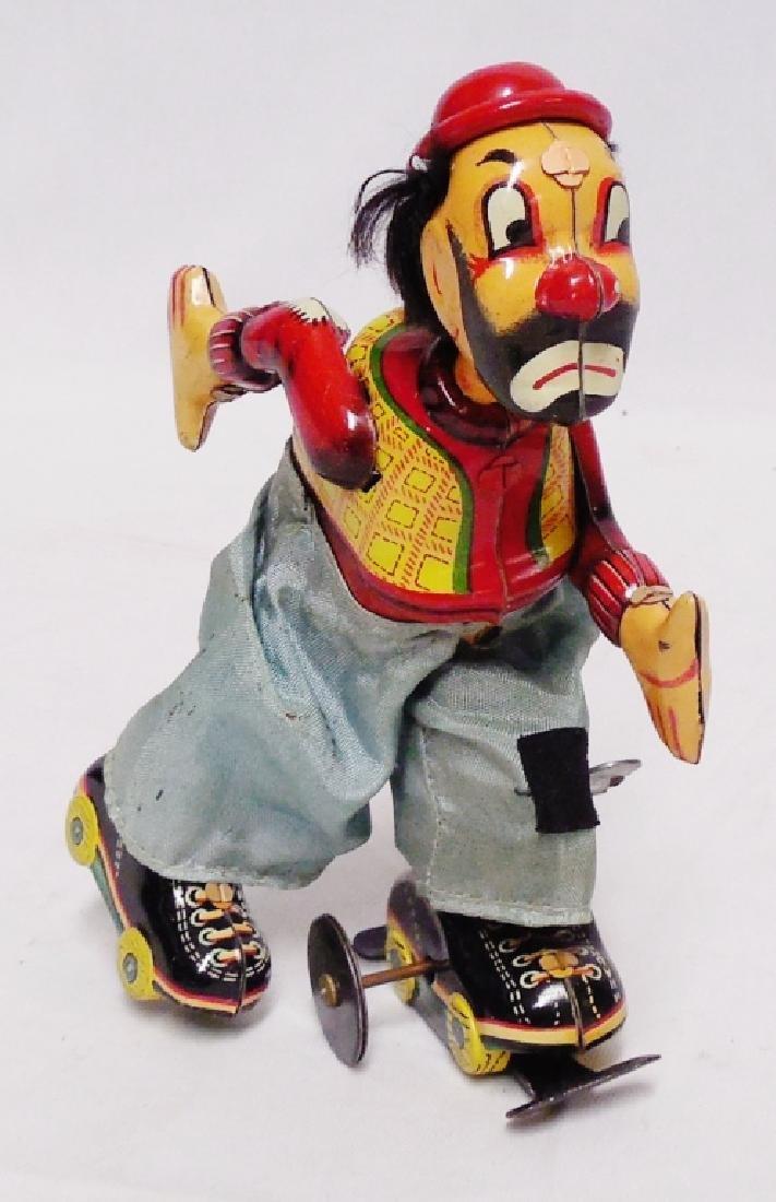 Tin Windup Clown Roller Skater