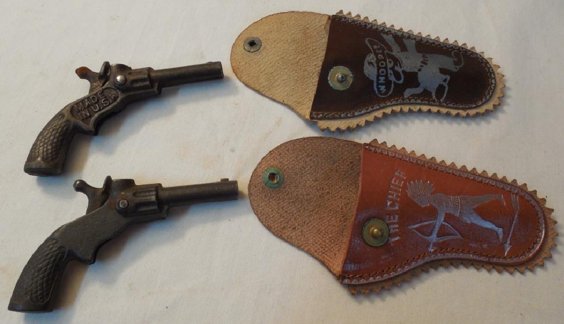 2 Small Cap Guns w/ Holsters