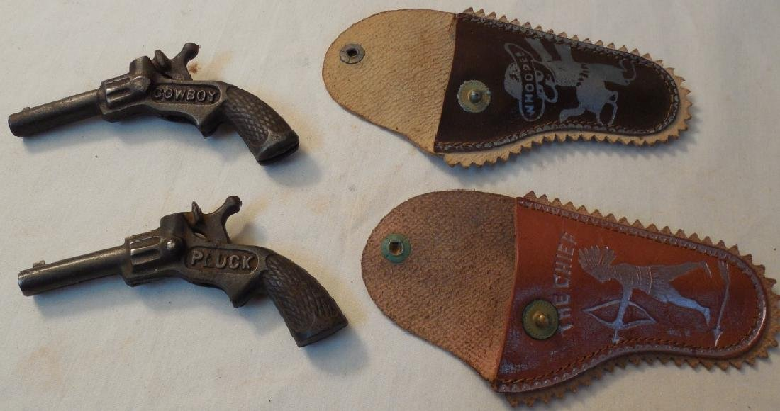 2 Small Cap Guns w/ Holsters - 2