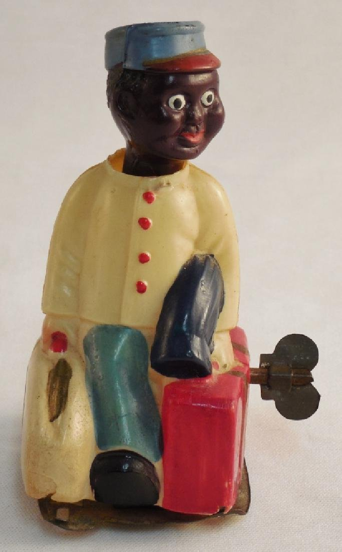 Celluloid Wind-Up Black America Toy