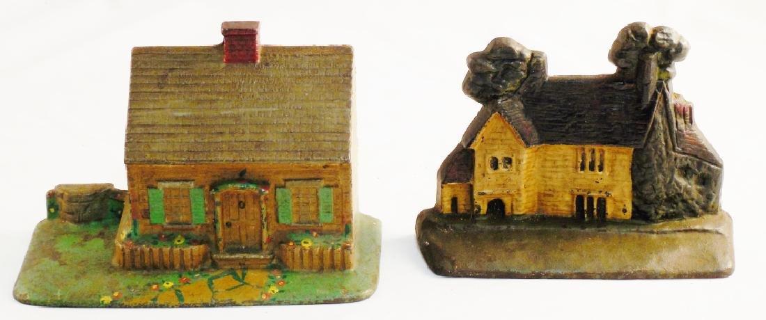 Lot of 2 Cast Iron Doorstops Both Houses