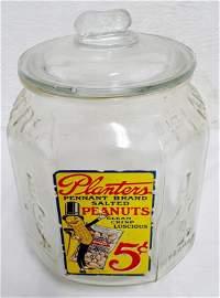 Mr. Peanut Counter Display Jar top of jar a little