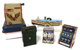 Lot of 4 tin banks & 1 cast iron boat