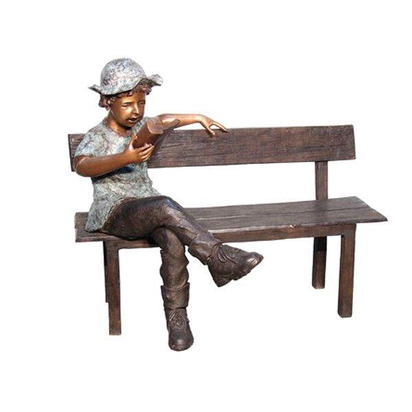Boy Sitting On Long Bench