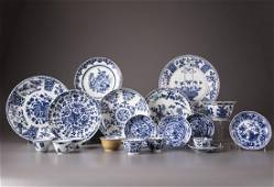 A group of 21 Chinese blue and white cups, saucers and
