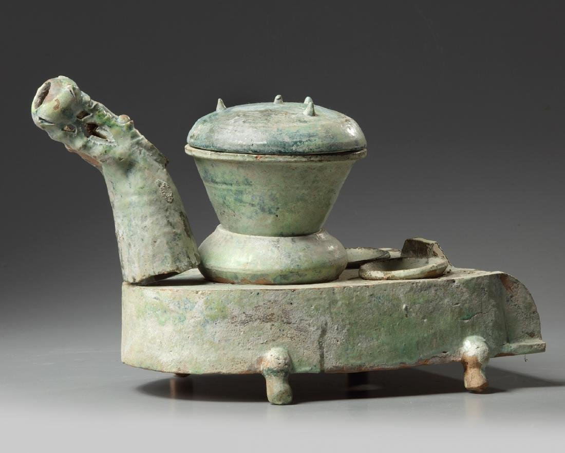 A Chinese green-glazed pottery stove with a dragon - 2