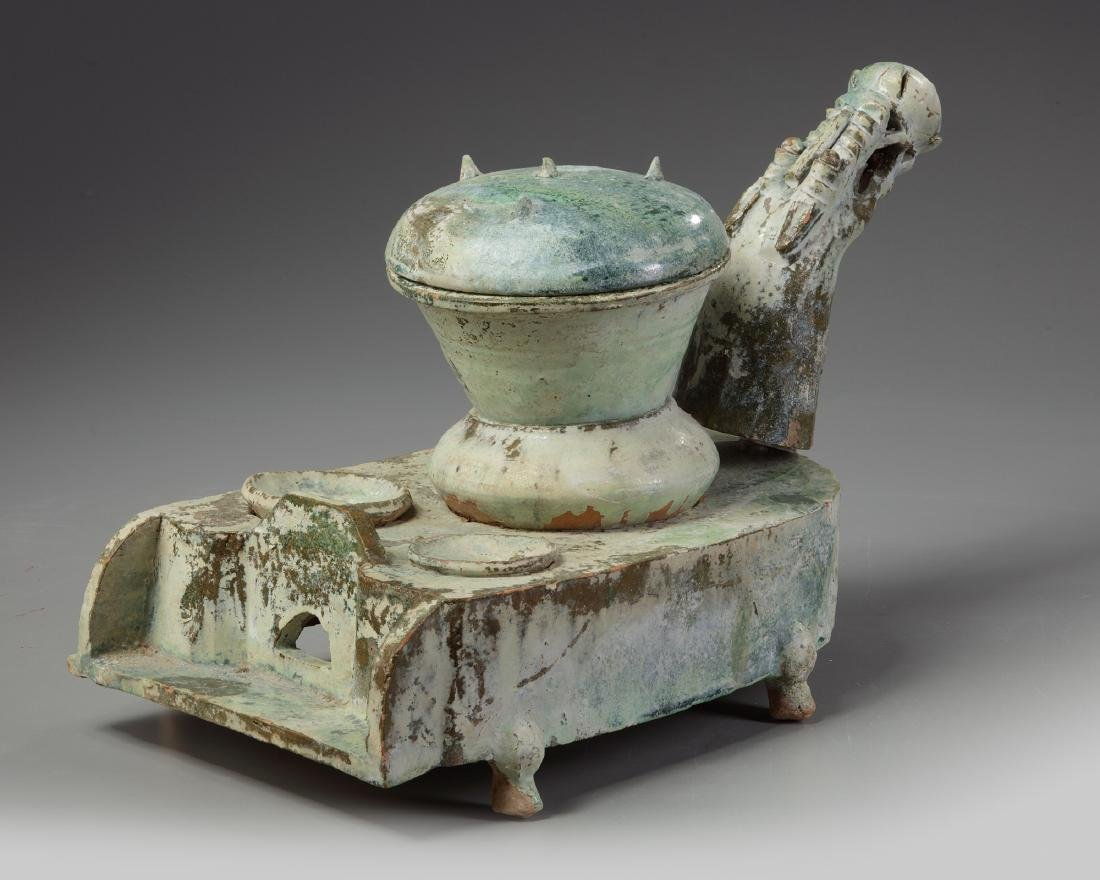 A Chinese green-glazed pottery stove with a dragon - 4