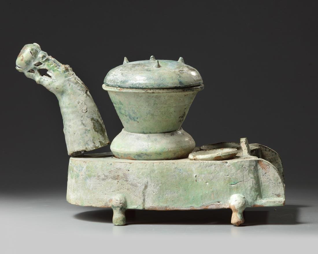 A Chinese green-glazed pottery stove with a dragon - 6