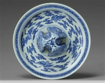A Chinese blue and white 'crane' jue stand