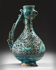 A RARE FRITWARE OPENWORK DECORATED RETICULATED EWER