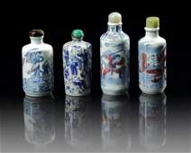 A GROUP OF FOUR CHINESE BLUE AND WHITE FIGURAL SNUFF