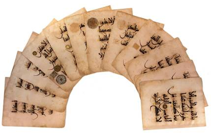 A RARE ANDALUSIAN QURAN SECTION ON PINK PAPER,