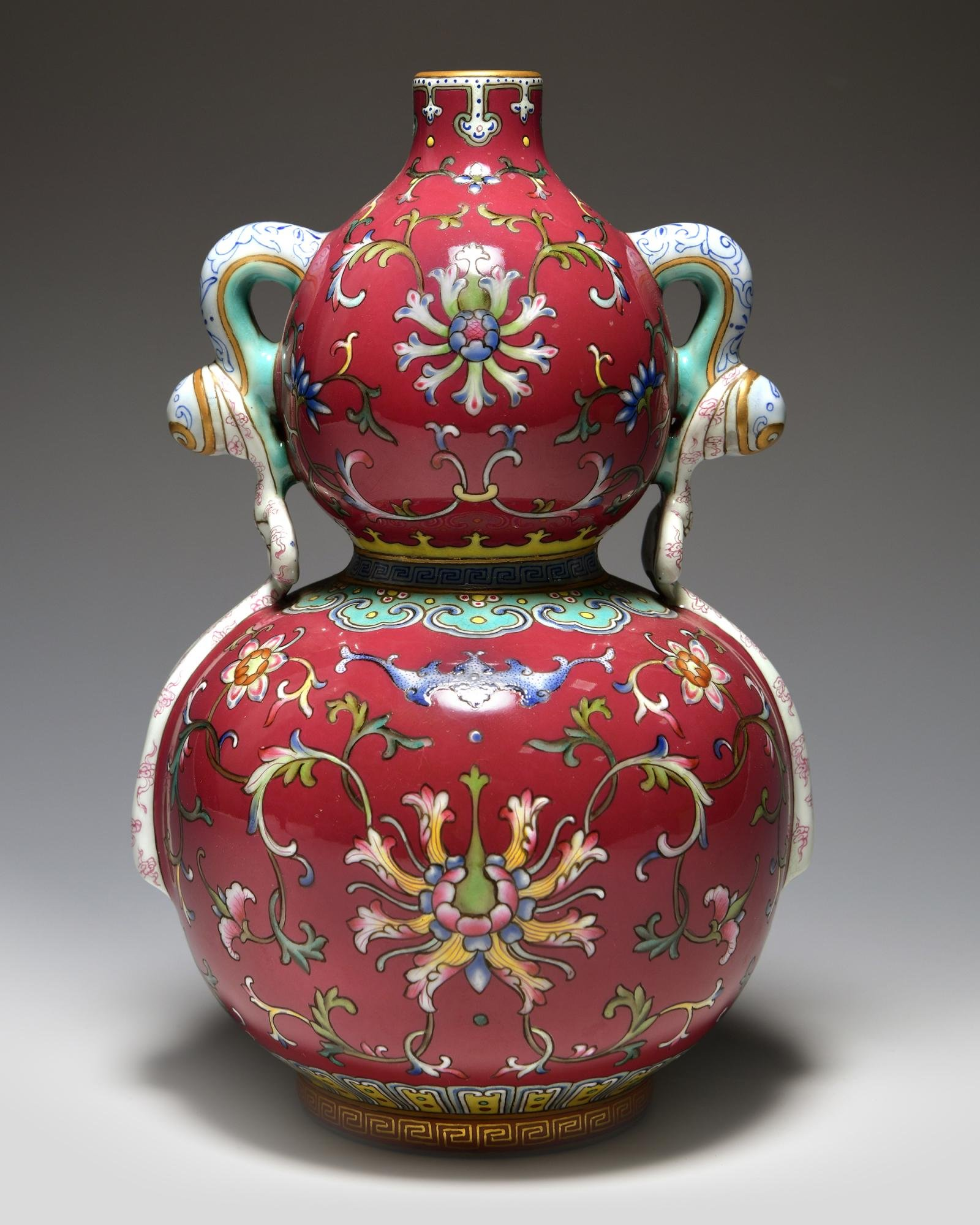 A CHINESE FAMILLE ROSE DOUBLE GOURD VASE