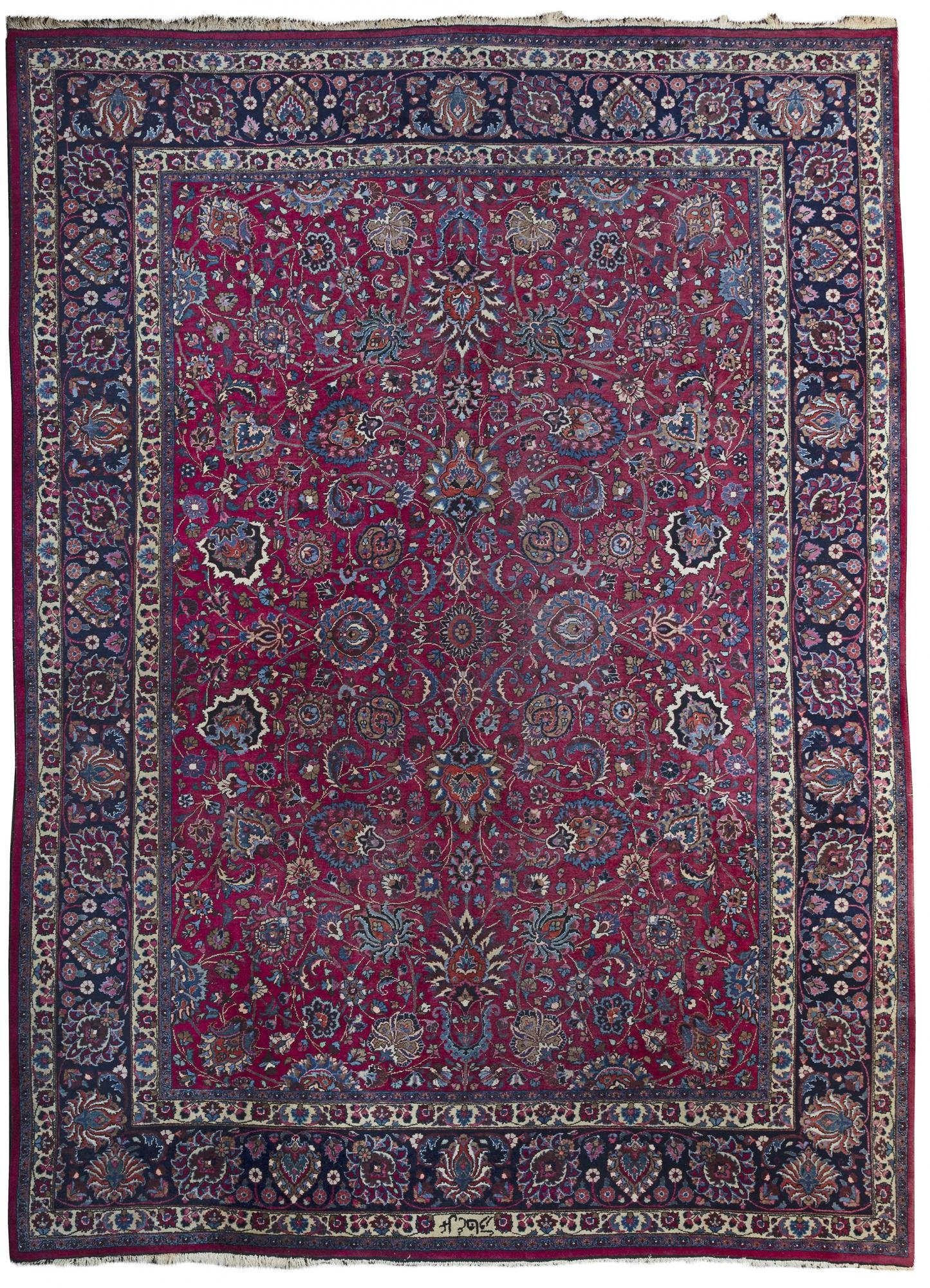 A LARGE SIGNED MESHED CARPET, NORTH-EAST PERSIA
