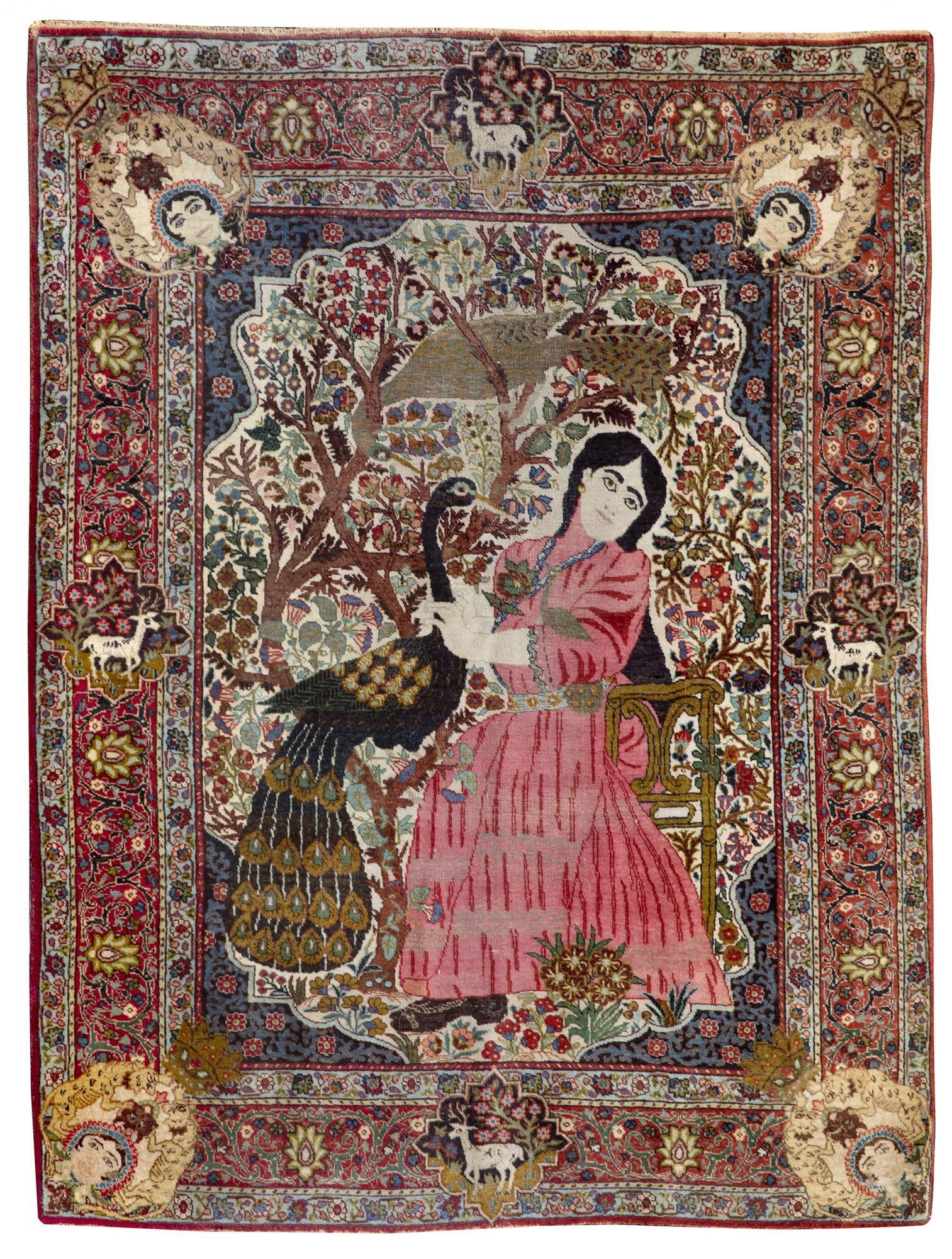 A PERSIAN TABRIZ RUG