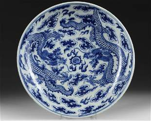 A CHINESE BLUE AND WHITE 'DRAGON' DISH, 19TH CENTURY