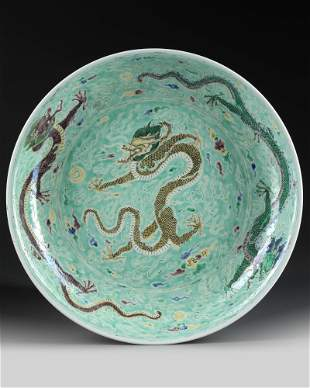 A CHINESE FAMILLE VERTE 'DRAGON' CHARGER, QING DYNASTY