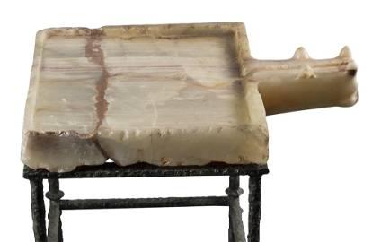A SOUTH ARABIAN ALABASTER LIBATION TABLE, CIRCA 1ST