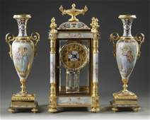 A FRENCH ORMOLU AND PORCELAIN CLOCK GARNITURE 19TH