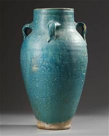 A LARGE TURQUOISE-BLUE GLAZED STORAGE JAR,  IRAN, CIRCA