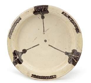 A PERSIAN NISHAPUR POTTERY DISH, PERSIA 12TH-13TH