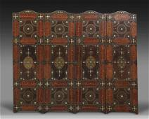 A FOUR PANEL LEATHER SCREEN, DATED 1346 AH /1927-28 AD