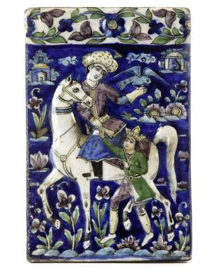 A QAJAR MOULDED POLYCHROME POTTERY TILE, PERSIA, 19TH