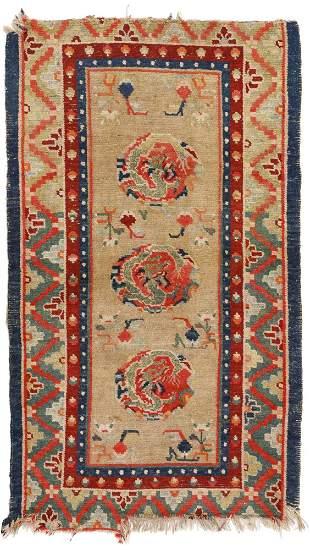 A SMALL TIBETAN RUG, CIRCA 1900