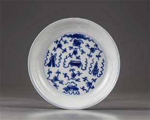 A CHINESE BLUE AND WHITE 'HUNDRED' TREASURES DISH,