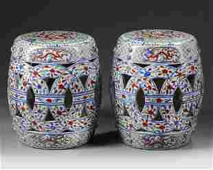 A PAIR OF CHINESE WUCAI GLAZED GARDEN SEATS, 19TH-20TH