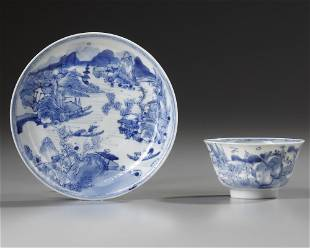 A CHINESE BLUE AND WHITE 'MASTER OF THE ROCKS' CUP AND