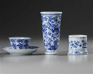 A GROUP OF THREE CHINESE BLUE AND WHITE STEMMED BEAKER