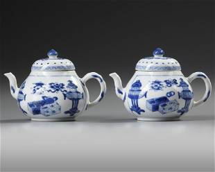 A PAIR OF SMALL CHINESE BLUE AND WHITE TEAPOTS AND