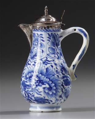 A CHINESE BLUE AND WHITE SILVER MOUNTED MILK JUG,